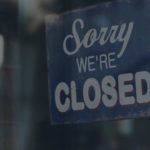 window sign that says Sorry We're Closed