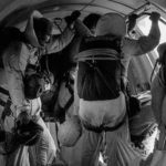 smokejumper firefighters inside airplane