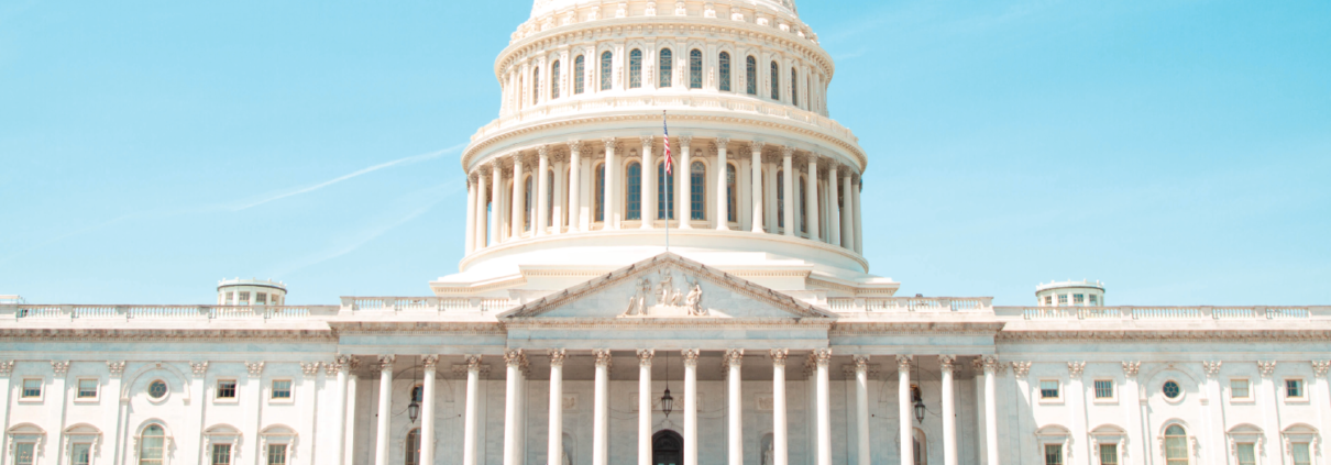 US Capitol Building on Bright Blue Background