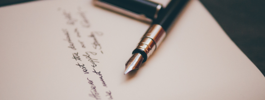 Paper with fountain pen and cursive writing